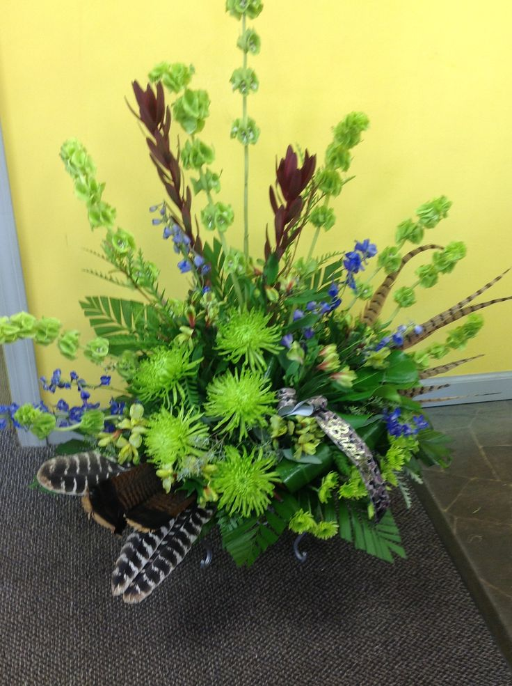 Green flowers with turkey feathers for a hunter. | Funeral arrangements | Pinterest | Feathers ...