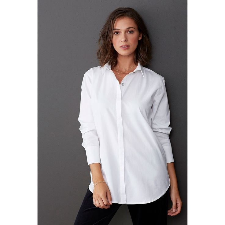This cotton women's oxford shirt is a luxurious basic you'll be wearing for years to come. Relaxed fit. Polished hidden button placket. Elegant back pleat.