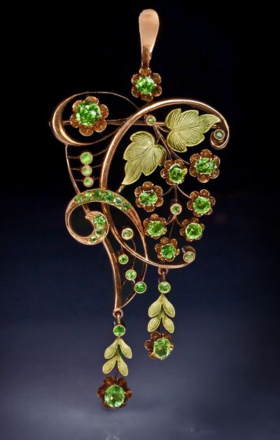 An Art Nouveau Demantoid Garnet and Two-Color Gold Pendant / Brooch  made in Moscow between 1908 and 1917
