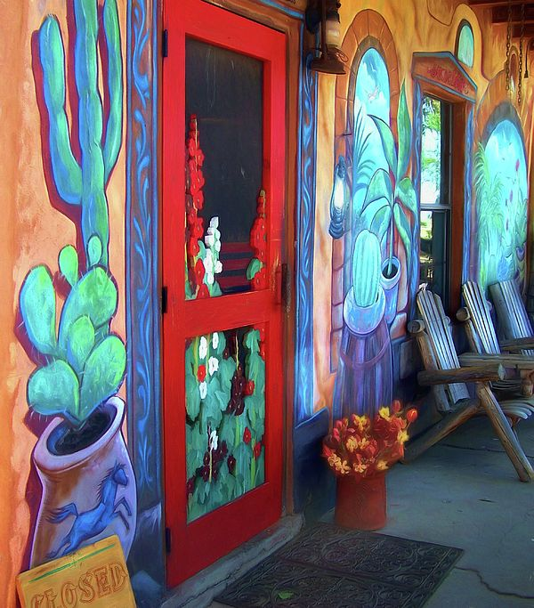 "The bright colors of ""Bienvenidos"" by Nikolyn McDonald bid a loud and clear ""Welcome"" to visitors to this New Mexico restaurant. porch,southwest,southwestern,verandah,door,painted wall,mural,chairs,adirondack chairs,flowers,pot,sign,closed,screen door,window,porch,covered porch,welcome mat,brightly colored,turquoise,red,blue,brown,orange,green,verandah,adobe,architecture,patio,entree,exterior,warm,pottery jar,exterior,stucco,entrance,entry,doorway,square,nikki,nikolyn,mcdonald"