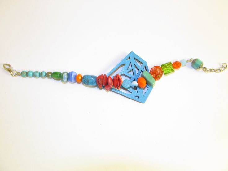 Handmade leather bracelet (1 pc)  Made with turquoise laser cut leather filigree, semiprecious stones and glass beads.