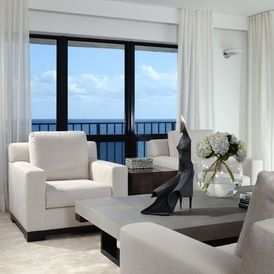 beach style family room with floor to ceiling ripple  fold pleated curtains