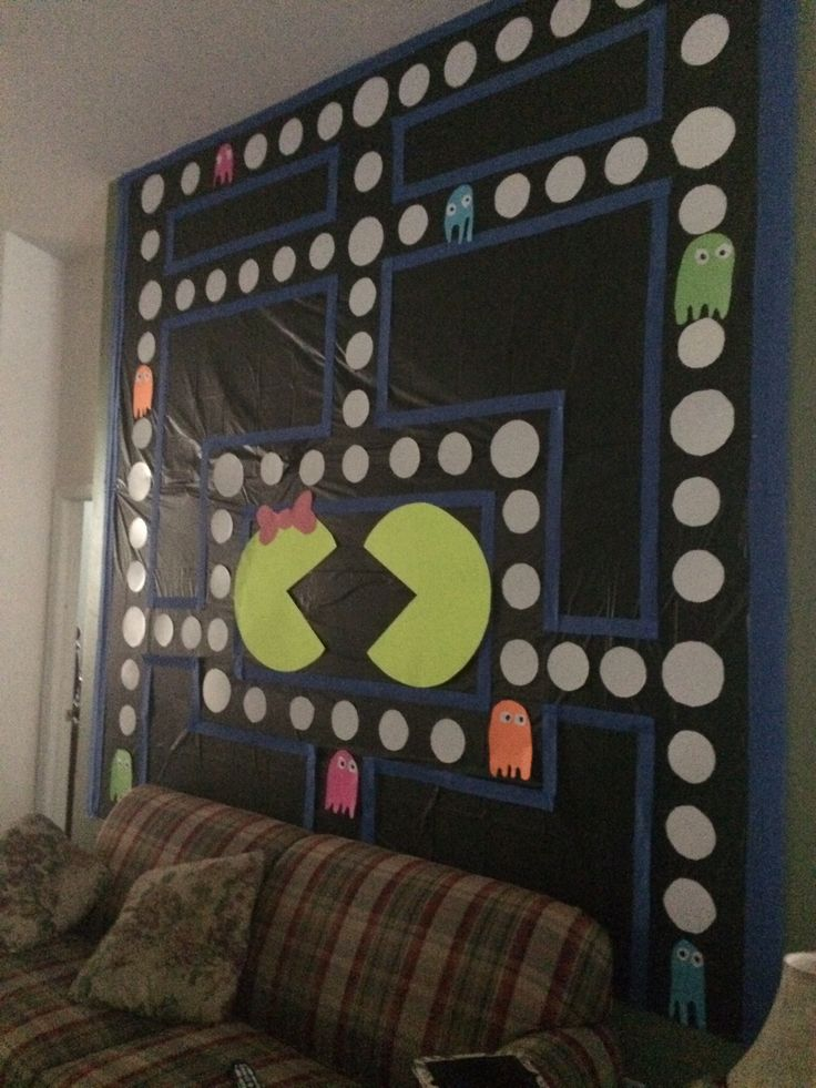 Pac Man wall Party Decoration! 80s Baby! Dollar store for this ENTIRE creation! 3 black plastic table clothes, 1 roll of blue streamers, small and large paper plates (cut the rippled edge off), different colored poster boards for the ghosts, and plenty of double-sided tape. We put Mom to work to create this party wall Masterpiece : )