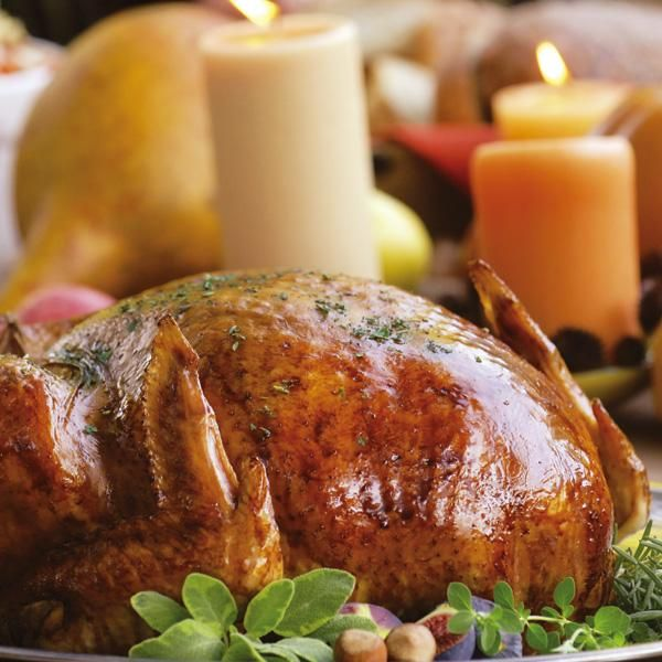 Herb Roasted Turkey- I put sprigs of fresh herbs and butter in the ...