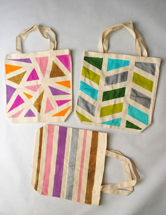 I could totally make these! painters tape, fabric paint and tote bags. Cute idea for pinterest party!