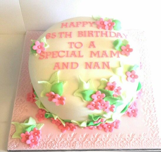 Pink flowers and ivy 65th birthday cake.