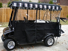 We spent the extra money on a Sunbrella golf cart enclosure - here's why: