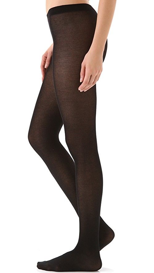 Falke Cotton Touch Tights | These tights feature an elastic waistband. 43% cotton/50% polyamide/7% elastane. Wash cold or dry clean. Made in Portugal.