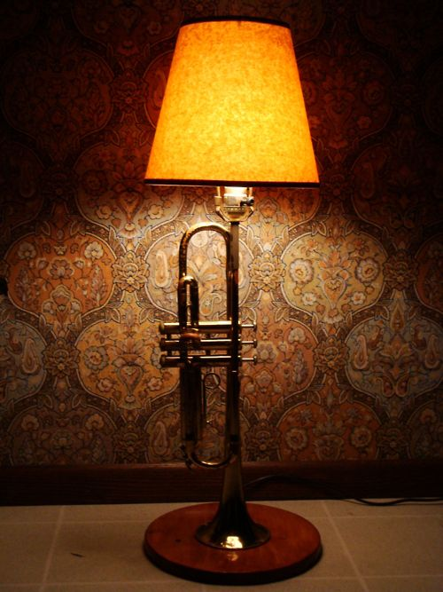 """This is a lamp i made for my mother for mothers day. it's made from a recycled lamp and my old trumpet that i used to play in junior high. the base was cut, sanded, stained and varnished by me. it took me longer than i expected, which is why i finished it almost a week after mothers day. As for the case that held the trumpet- i'll be turning that into a toolbox. :D"""