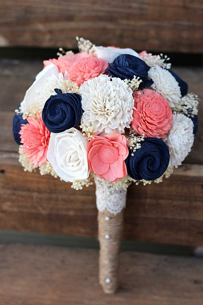 I love the pink in this, and the blue is close to the colors of the bridesmaid's dresses, although I wouldn't want flowers that color.  Disregard the shape. and the