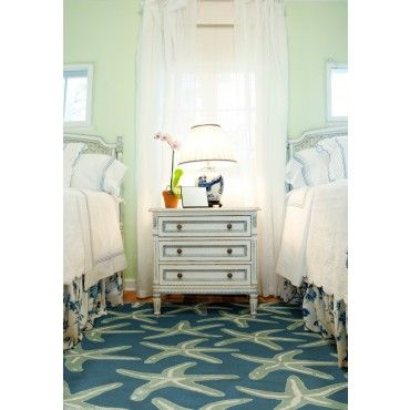 Hand Tufted Blue Wool Starfish Area Rug via Canon's Beach House   comes in various sizes. I like the overall decor of the bedroom.