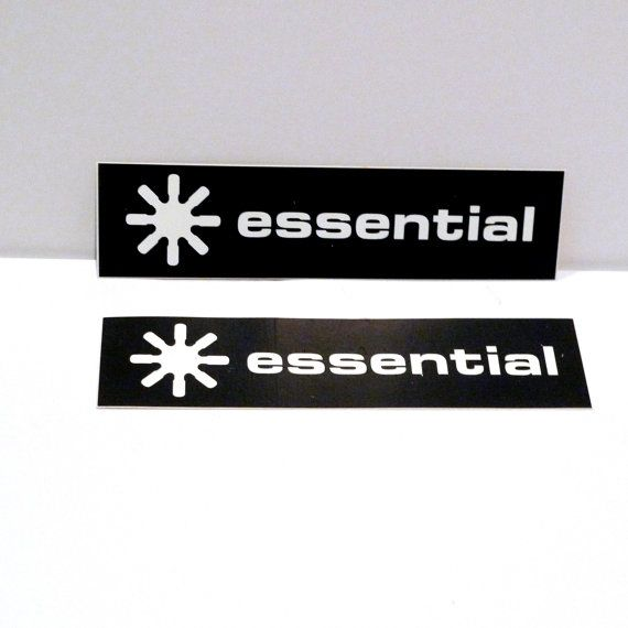 Essential - Set of 2 Record Label Promotional Stickers - 1990s - Measurements: 1 x 4 inches The vintage sticker is like new with original backing and has not been used / never peeled. This is a promotional sticker for a cool record label that focused on global dance music. It was an Essential Record Label Logo promotional only sticker and not sold commercially to the public. We received it at our Mohawk Music Record Store in Tulsa, Oklahoma. Tags/marks/id: the backing reads - global dance…