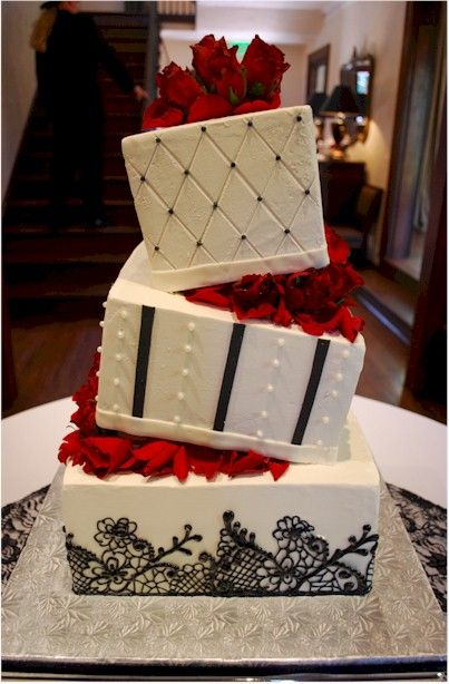 Cup a Dee Cakes Blog: Black Lace Wedding Cake with Wedge Separators love it if it were purple and not red