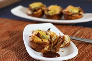 Pulled pork isn't just for sandwiches! Take a look at this slideshow for new and inventive ideas and recipes for pulled pork appetizers, pizza, empanadas, egg rolls, and more.: Pulled Pork Barbecue Biscuit Cups