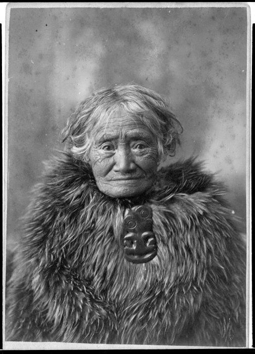 Merenako of Motueka, also known as Old Biddy, as an old woman wearing a kahukiwi (Maori kiwi feather cloak) and hei tiki (carved figure worn around the neck). Photographer unidentified.1880's.