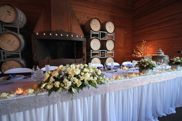 white roses used on long wedding table, vintage -modern combination of wedding  decorations, wedding reception held at Frogmore Creek Wines
