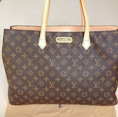 LOUIS VUITTON WILSHIRE - I splurged on this bag in Paris. When I wear it, I feel fabulous!