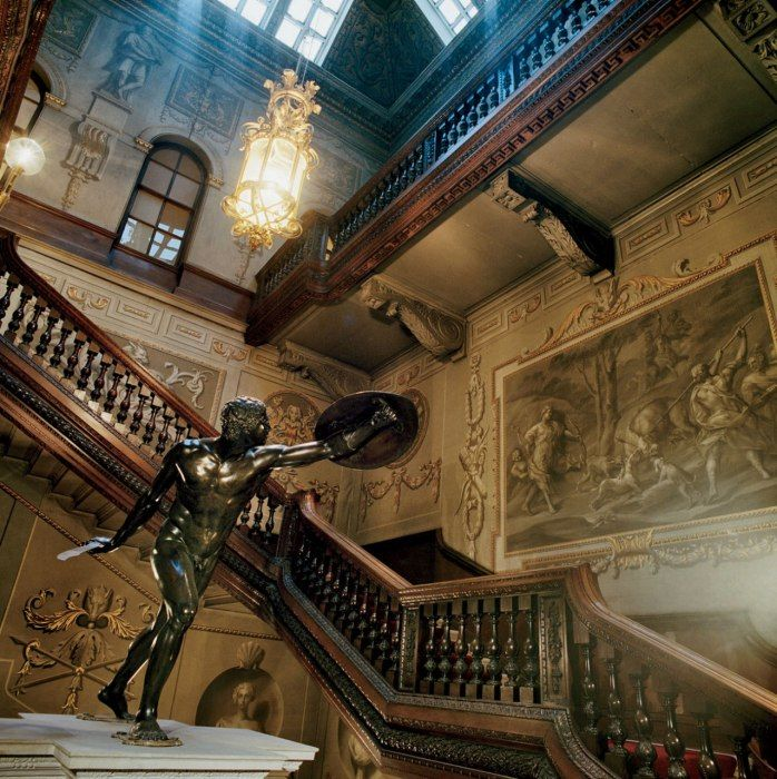 The Great Staircase at Houghton Hall in Kings Lynn, Norfolk, England. The staircase features grisaille paintings by designer William Kent.