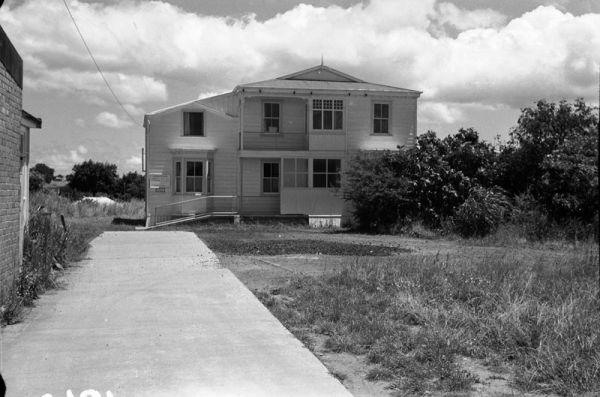 House opposite New Lynn Post Office (now Police Station) Great North Rd, New Lynn. 1962. This house was originally the home of the Grandison family. The building was moved back from its Great North Rd frontage. Source: Russell Woolley. JTD-11A-01842