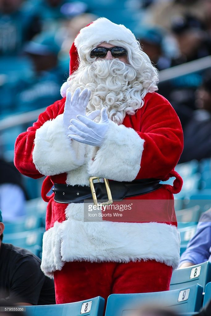 A fan dressed as Santa Claus during the NFL game between the Atlanta Falcons and the Jacksonville Jaguars at Everbank Field in Jacksonville, Fl.