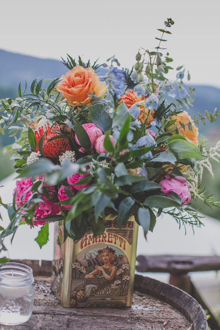 Outdoor Wedding Ceremony in Tuscany With Bright Florals And Rustic Wooden Seating - Tuscany Wedding Planner Wedding With Vibrant Decor And A Classic Italian Twist Wedding In Wonderland Images by Rosa Paola Lucibelli
