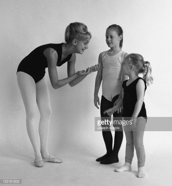 American dancer and dance instructor, and future actress, Goldie Hawn instructs two of her young ballet students, Arlington, Virginia, September 29, 1964.
