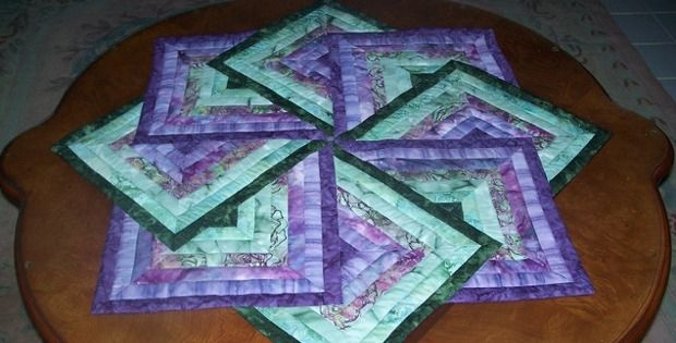 Choose Fabrics for Any Season! This gorgeous table topper is often called Strata Star, Spinning Star and Card Tricks. The version below in green is called, appropriately, the Irish Star. Photo courtesy of Creative Quilt Kits who has as a pattern available. The table topper is beautiful in any colorway. We especially like it made …