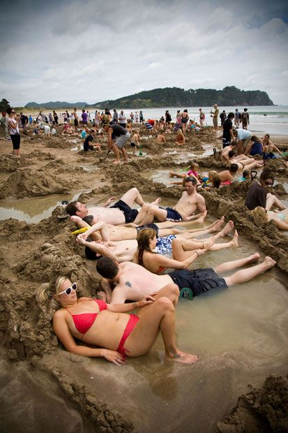 Hot Water Beach, New Zealand  Set on the Coromandel Peninsula, this strip is the seaside equivalent of underfloor heating. Subterranean hot springs filter up through the sand and, either side of low tide, visitors can burrow down and create their own hot-water pool in which to soak.