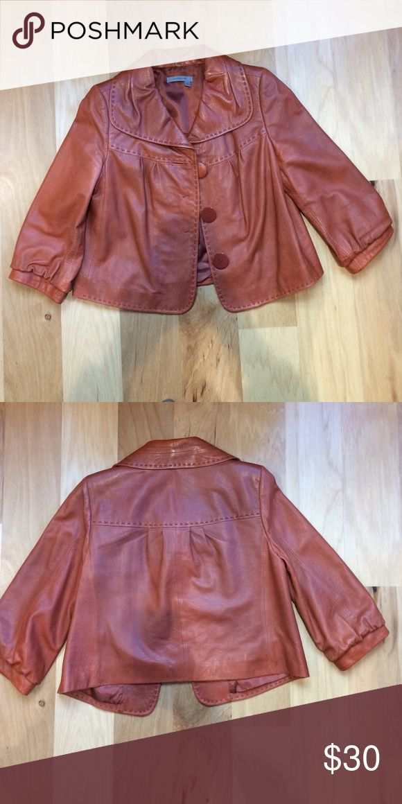 Cropped leather jacket Cropped rust leather jacket with large button details from Classique Entier. 100% Leather. Jackets & Coats