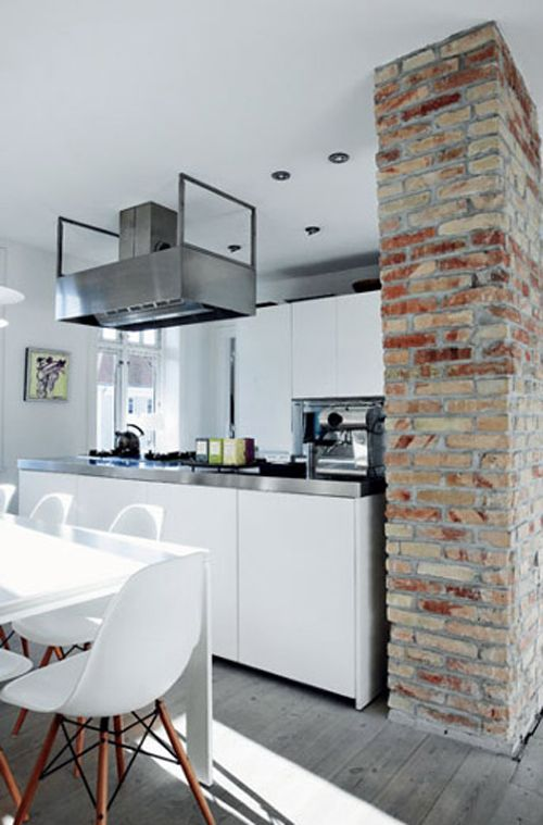 Kitchen with brick wall