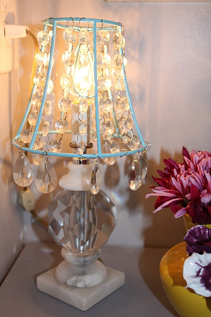 Tear off fabric from old lamp shade, spray paint and attach beads with wire.