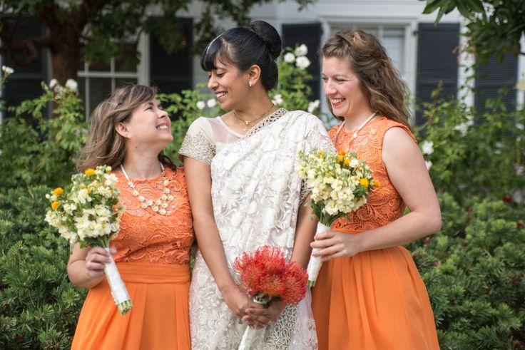 Flowers by Teresa Soleau. Photo by Matt Misisco. Bride. Bridesmaids. Bouquet. Stock. Safflower. Pincushion protea. Orange. Yellow. Ivory.
