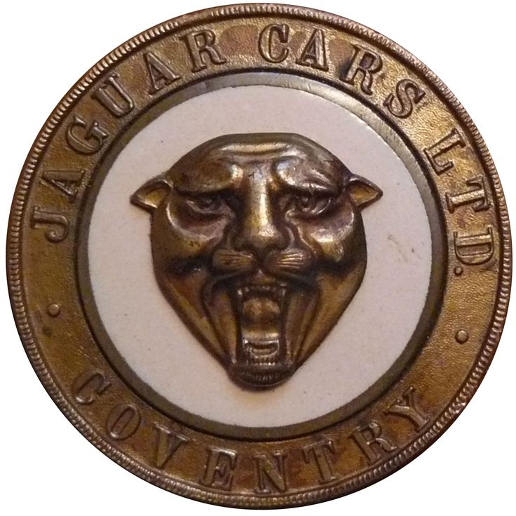This very rare badge is in two parts with a central fixing stud. It is unplated bronze with the cream enamelled centre showing the jaguar head. Measuring just over 2 inches in diameter it has understated beauty.