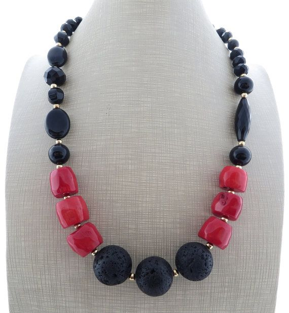 Black lava necklace, red coral and onyx necklace, chunky necklace, beaded necklace, big bold necklace, lava rock jewelry, stone jewelry    Stunning chunky necklace with black onyx, black lava rock, red bamboo coral and black czech beads.  Glamour, chic, unique !     Necklace length: 20.9 inches - 53 cm Gold tone   Italian gemstone jewelry  Free gift box with every purchase      Sofias Bijoux jewellery:  http://www.etsy.com/it/shop/Sofiasbijoux      *******************...