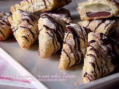 Triangoli sfogliati alla nutella, facili, veloci e buonissimi, sono fragranti e il ripieno goloso rende questi dolcetti di pasta sfoglia irresistibili ..