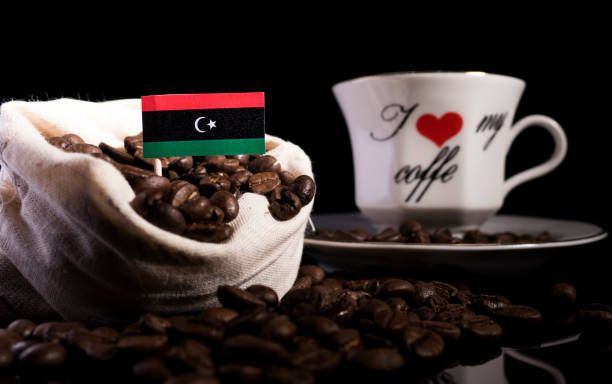 libyan flag in a bag with coffee beans isolated on black background