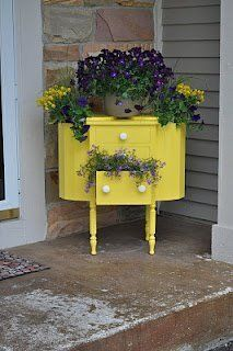 Antique Martha Washington sewing table redone to greet guests with happy pansies.