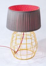 Pleated lamp shade with wire fragment base in ochre.