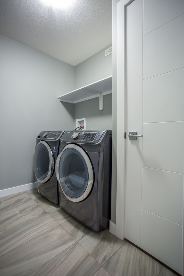 Laundry in it's own room with broom closet.