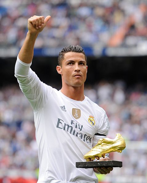 Cristiano Ronaldo of Real Madrid salutes with his Golden Shoe award during the La Liga match between Real Madrid CF and Levante UD at estadio...