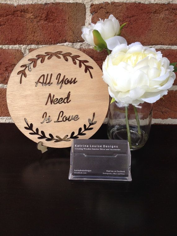 The cut out ALL YOU NEED IS LOVE timber plaque with wreath is created and designed by Katrina Louise Designs for Engagements, Weddings, gifts and decorations.