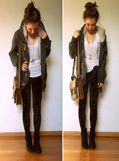 black jeans (or dark colored) dark colored boots or high tops  neural colored shirt (suggested to be white) simple long neclase. and cartagin or long jacket . hair up or down