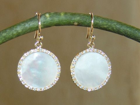 Beautiful dime size mother of pearl earrings surrounded by diamonds, by Georgina Whitford.