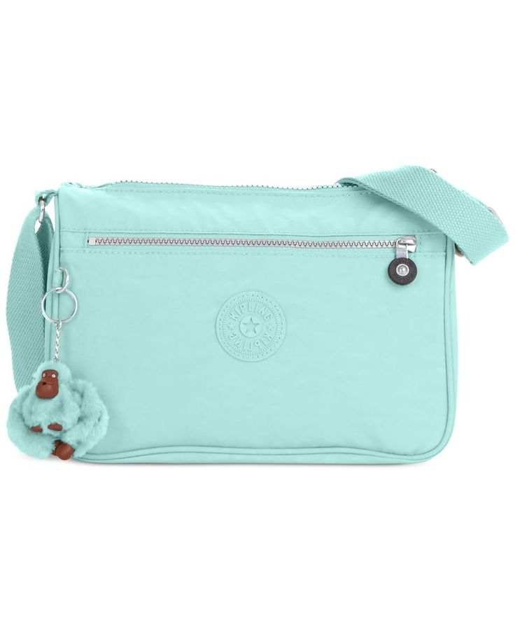 Busy days on the go deserve easygoing style, like this compact crossbody from Kipling. Cut from crisp nylon with two interior compartments, the outside zip pocket keeps essentials easily at hand. | Im