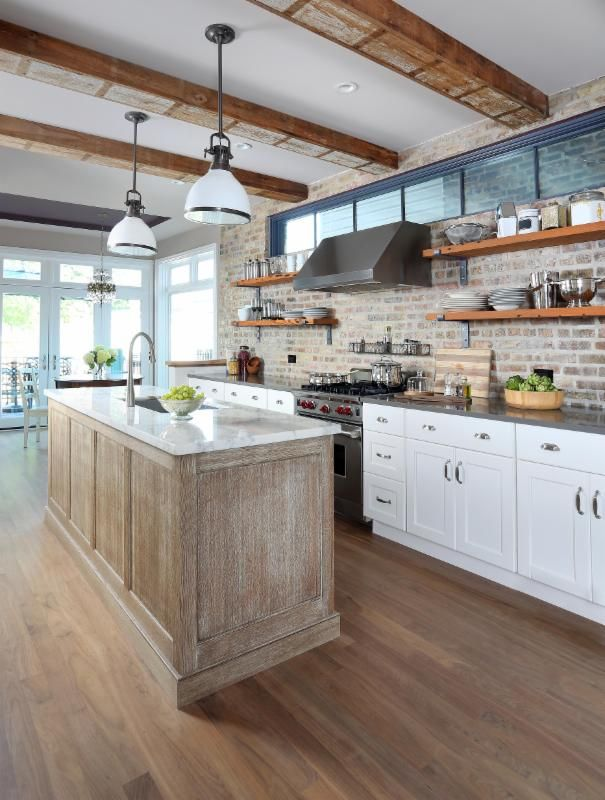 This young professional couple had been renovating their old shotgun Chicago brick home for a few years. They wanted a wow kitchen that fit their modern personalities and their vintage home. What do you think of the eclectic style?