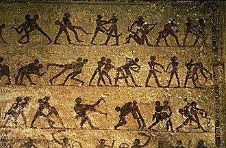 20th century BC – Murals in tomb 15 at Beni Hasan, depicting wrestling techniques.