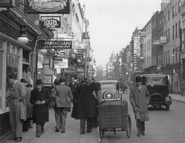 1939 March Old Compton Street. All the people seem to be men. To see the same place today see my next pin in the London board.