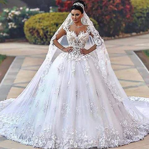 ornate wedding dresses with tons of beaded lace and embellishments look expensive but do not have