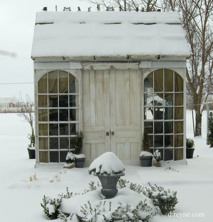 Little garden house made from recycled windows & doors. This makes winter look appealing.