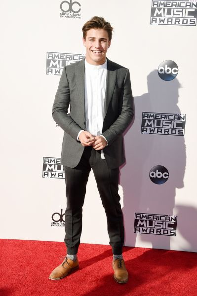 Internet personality Tanner Zagarino was all smiles in a gray suit. (Photo by Steve Granitz/WireImage) via @AOL_Lifestyle Read more: http://www.aol.com/article/2015/11/22/full-list-of-winners-at-the-american-music-awards/21270858/?a_dgi=aolshare_pinterest#slide=3714357|fullscreen